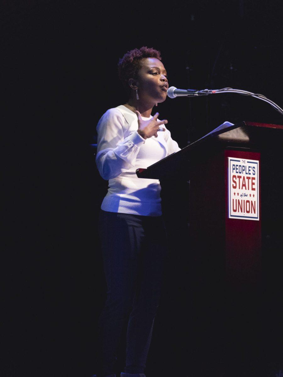 Karine Jean-Pierre speaks at a podium.