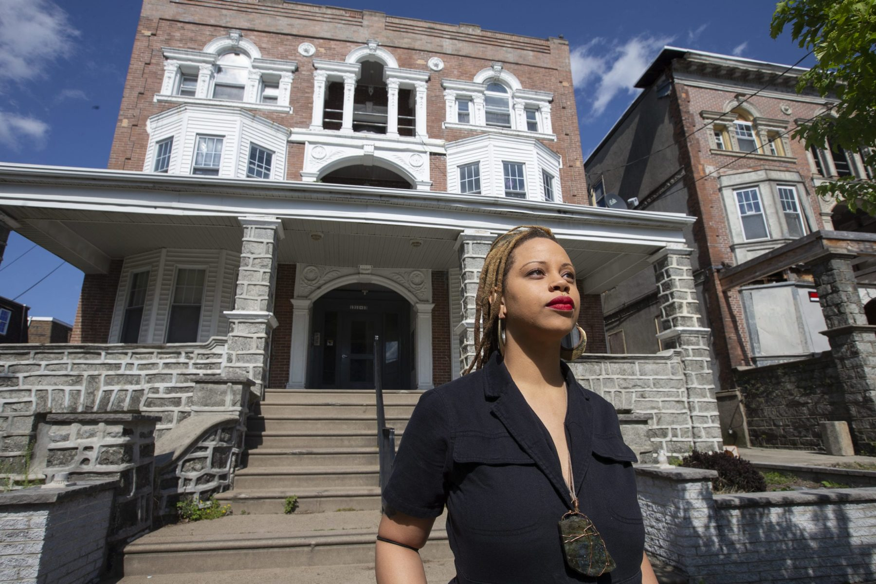 Shani Akilah of The Black and Brown Workers' Collective organized her fellow tenants to ensure that their landlord did not kick them or their neighbors out of their six-unit apartment building in southwest Philadelphia. She is shown in front of the building on April 15, 2020.