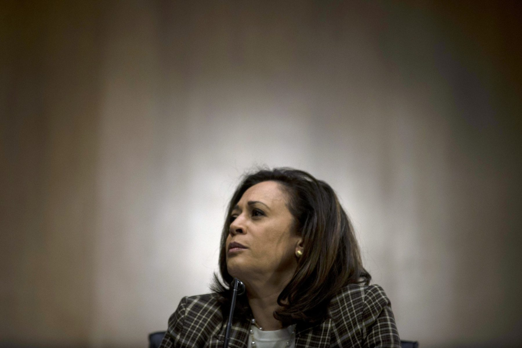 Kamala Harris against a solid background.