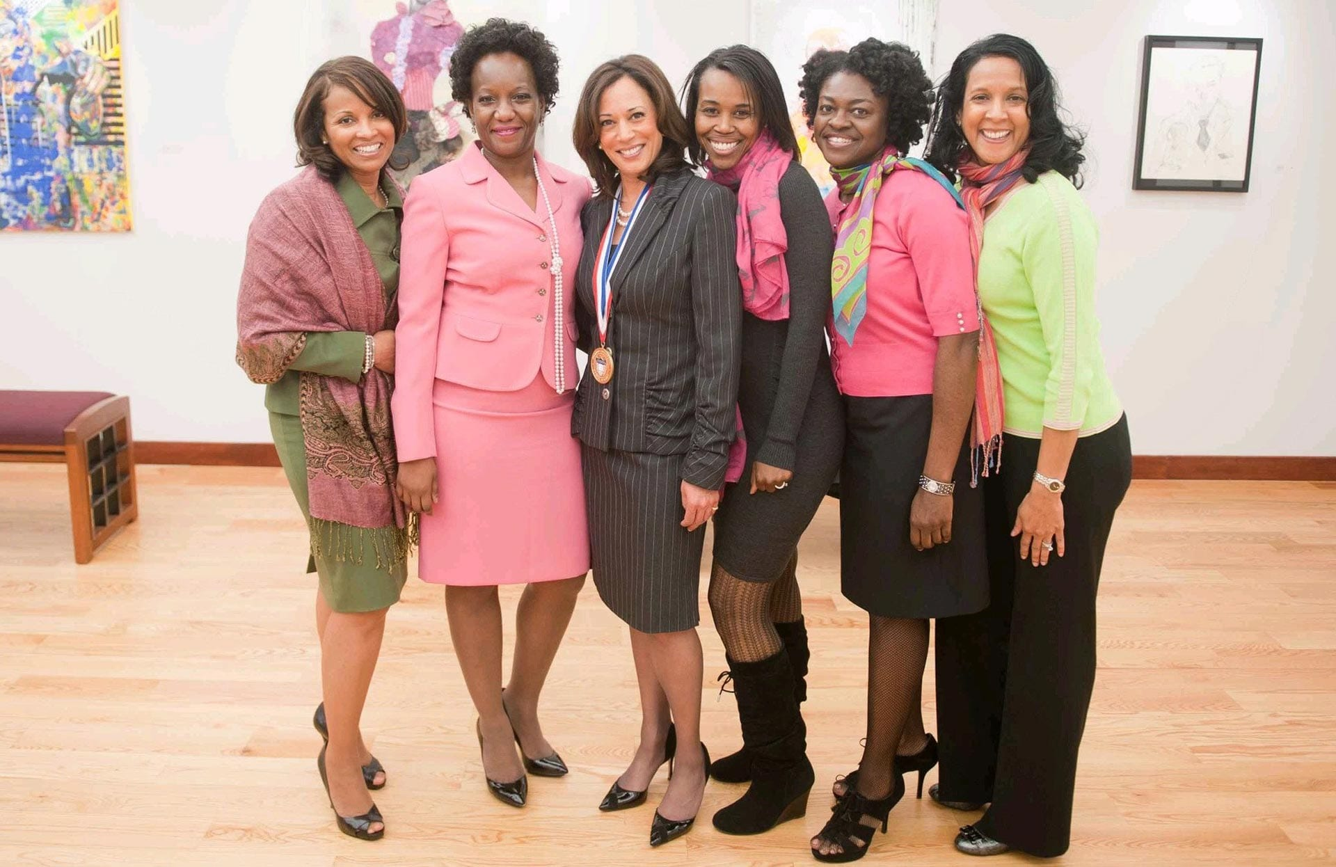 Kamala Harris standing with a group of women.