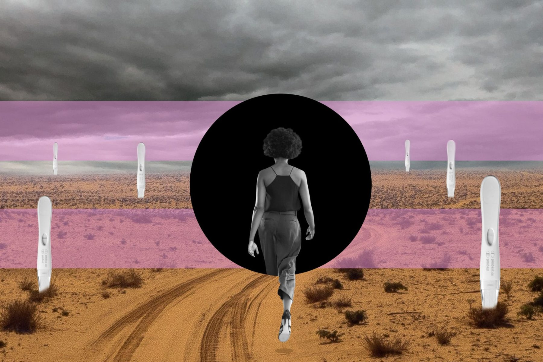 A woman walking into a black hole in a desert.