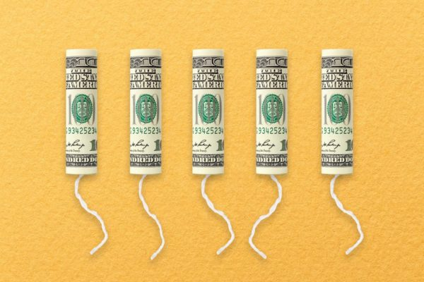 A row of tampons with $100 bills on them.