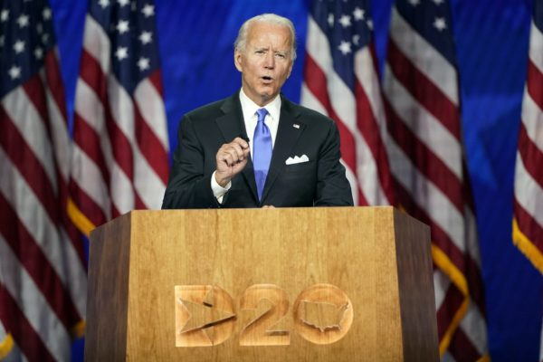 Joe Biden standing at a podium during the Democratic National Convention.
