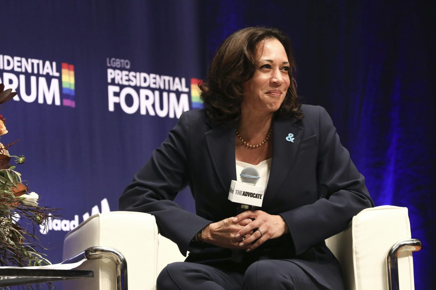 Kamala Harris smiling on stage.