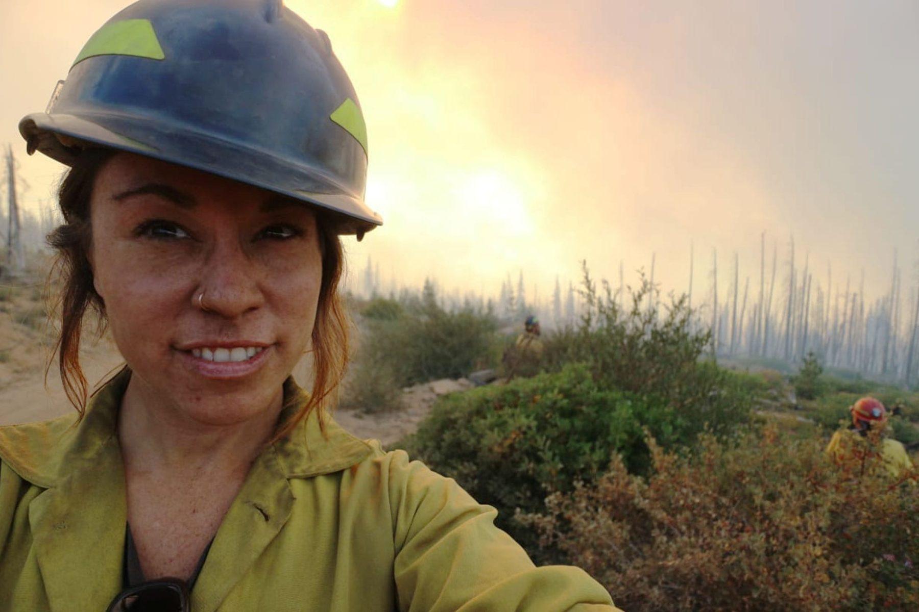 Eleonore Jordan Anderson takes a selfie in front of a landscape.
