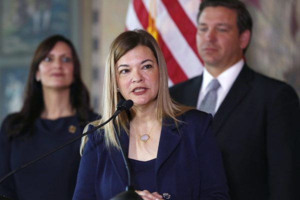 Barbara Lagoa, center, Governor Ron DeSantis' pick for the Florida Supreme Court, speaks after being introduced, as DeSantis and Lieutenant Governor Jeanette Nunez, left, look on, Wednesday, Jan. 9, 2019, in Miami. (AP Photo/Wilfredo Lee)