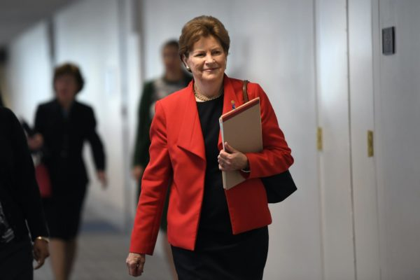 Sen. Jeanne Shaheen of New Hampshire, in a red blazer, arriving for a meeting on Capitol Hill in 2020.