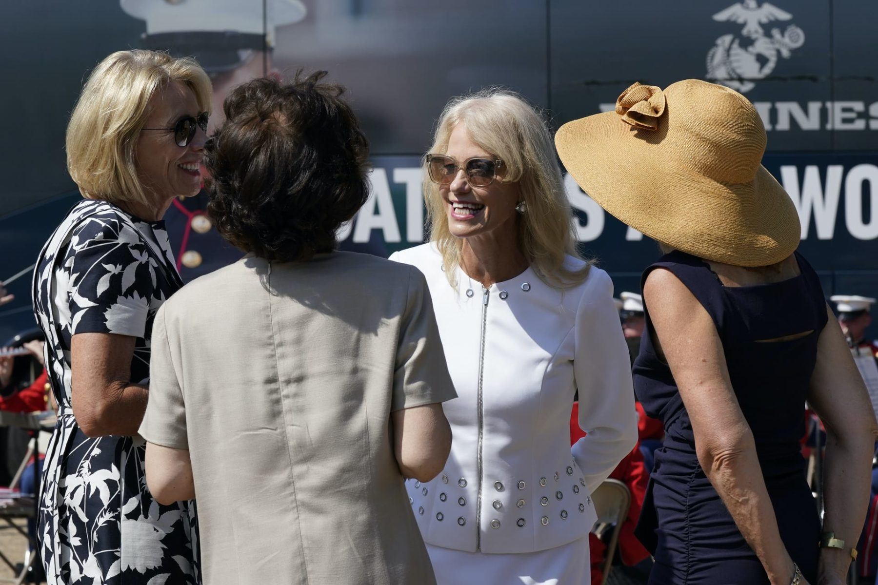 Kellyanne Conway, one of President Donald Trump's most influential and longest serving advisers, speaks with Education Secretary Betsy Devos, left, and Transportation Secretary Elaine Chao, second from left, at an event with First Lady Melania Trump, in front of the White House in Washington, Monday, Aug. 24, 2020. Conway announced Sunday that she would be leaving the White House at the end of the month, citing a need to spend time with her four children. (AP Photo/J. Scott Applewhite)
