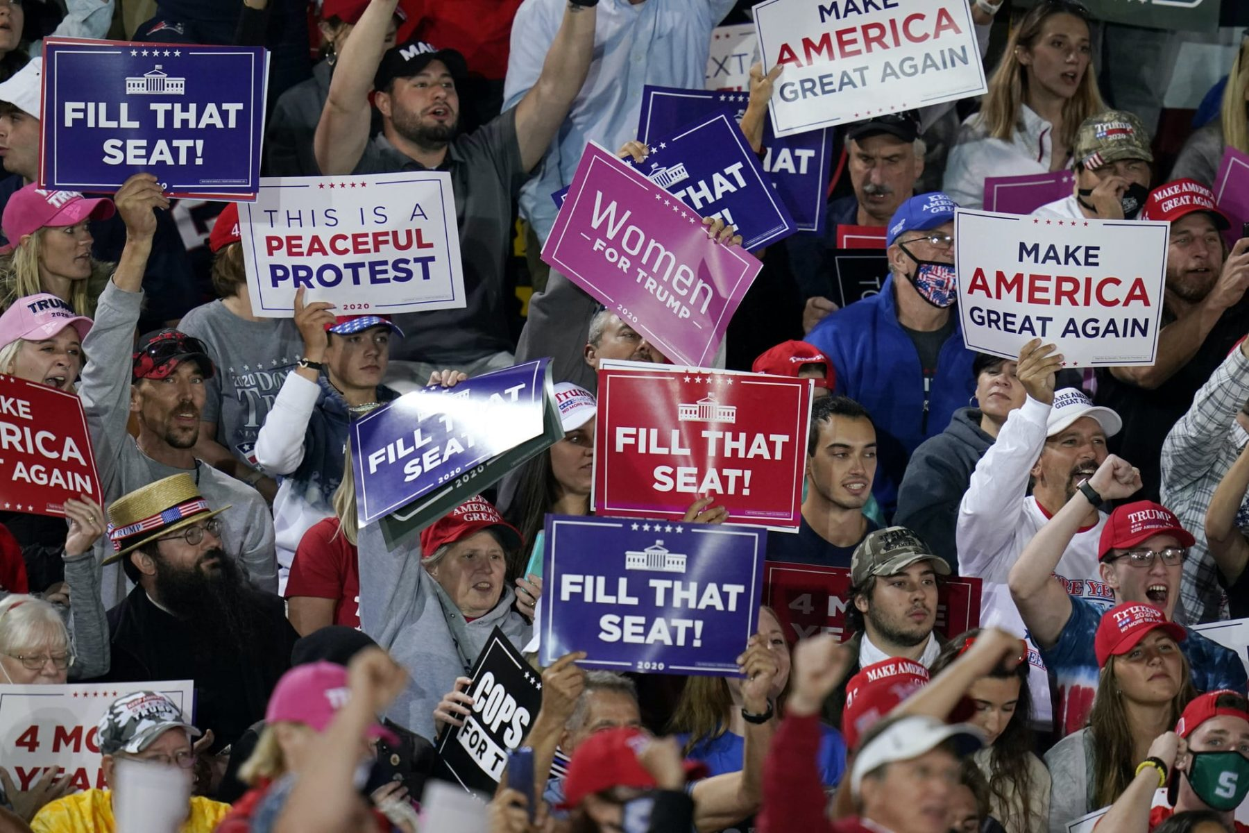 Supporters of President Donald Trump cheer as he speaks at a campaign rally, Tuesday, Sept. 22, 2020, in Moon Township, Pennsylvania.