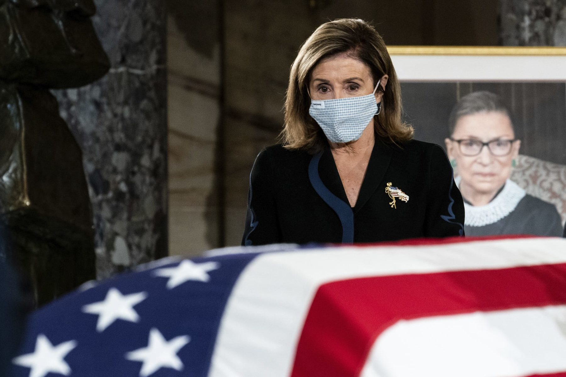 House Speaker Nancy Pelosi pays her respects to Justice Ruth Bader Ginsburg as she lies in state in the U.S. Capitol on Friday, Sept. 25, 2020. Ginsburg died at the age of 87 on Sept. 18 and is the first women to lie in state at the Capitol.