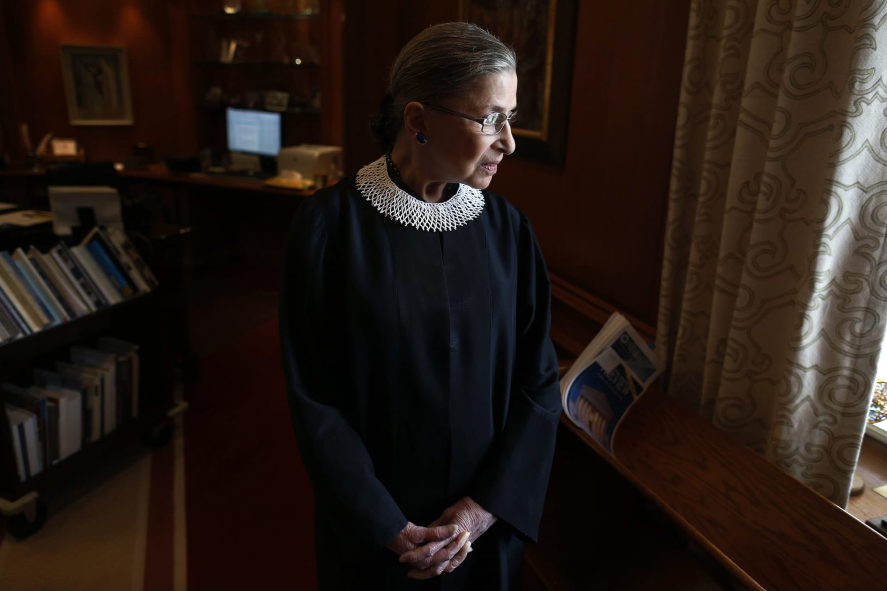 Associate Justice Ruth Bader Ginsburg poses for a photo in her chambers at the Supreme Court in Washington, Wednesday, July 24, 2013, before an interview with the Associated Press. Ginsburg said during the interview that it was easy to foresee that Southern states would push ahead with tougher voter identification laws and other measures once the Supreme Court freed them from strict federal oversight of their elections.