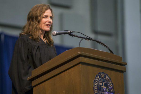 Amy Coney Barrett gives a speech at a podium.