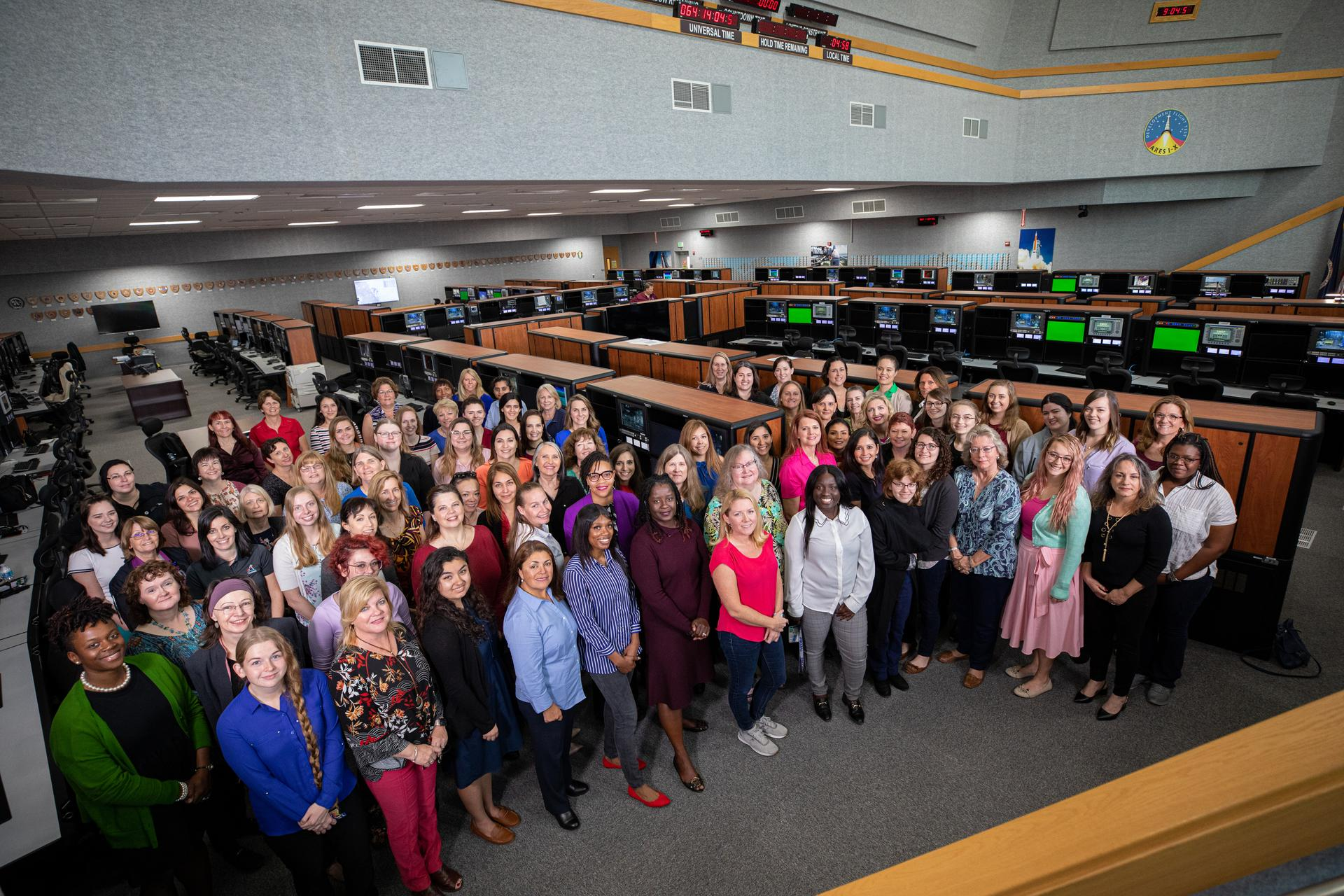 "In celebration of Women's History Month, the ""Women of Launch Control"" working in Exploration Ground Systems take time out of their Artemis I launch planning to pose for a photo in Firing Room 1 of the Launch Control Center at NASA's Kennedy Space Center in Florida on March 4, 2020. Artemis I will be the first integrated flight test of the Orion spacecraft and Space Launch System rocket, the system that will ultimately land the first woman and the next man on the Moon."