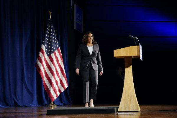 Kamala Harris walks toward a podium.