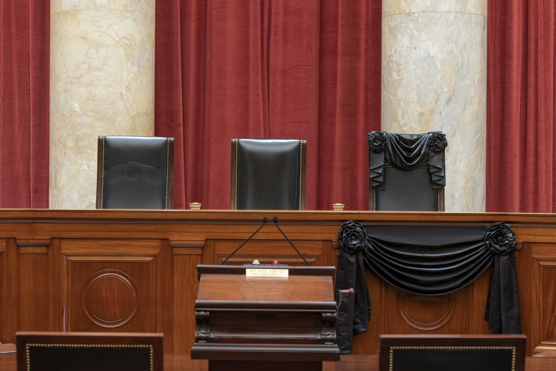 The bench at the U.S. Supreme Court draped in black.