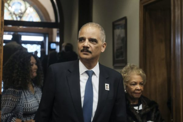 Former Attorney General Eric Holder arrives for a ceremony to unveil the new Gwen Ifill Black Heritage Commemorative Forever Stamp during a Postal Service ceremony at the Metropolitan African Methodist Episcopal Church, Thursday, Jan. 30, 2020, in Washington.