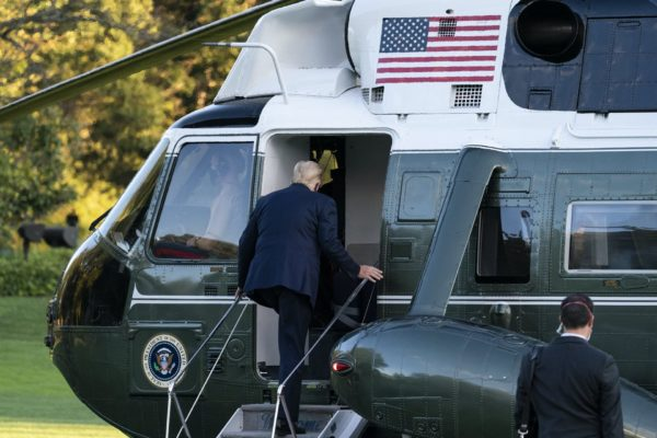 President Donald Trump boards Marine One as he leaves the White House to go to Walter Reed National Military Medical Center after he tested positive for COVID-19, Friday, Oct. 2, 2020, in Washington. (AP Photo/Alex Brandon)