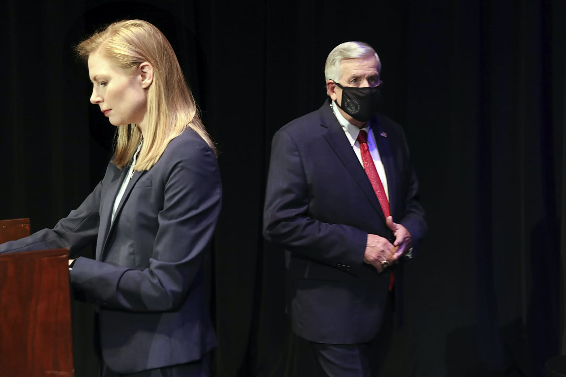 Missouri gubernatorial candidates, Gov. Mike Parson, and State Auditor Nicole Galloway are seen onstage before the Missouri gubernatorial debate at the Missouri Theatre on Friday, Oct. 9, 2020 in Columbia, Missouri. (Robert Cohen/St. Louis Post-Dispatch via AP, Pool)