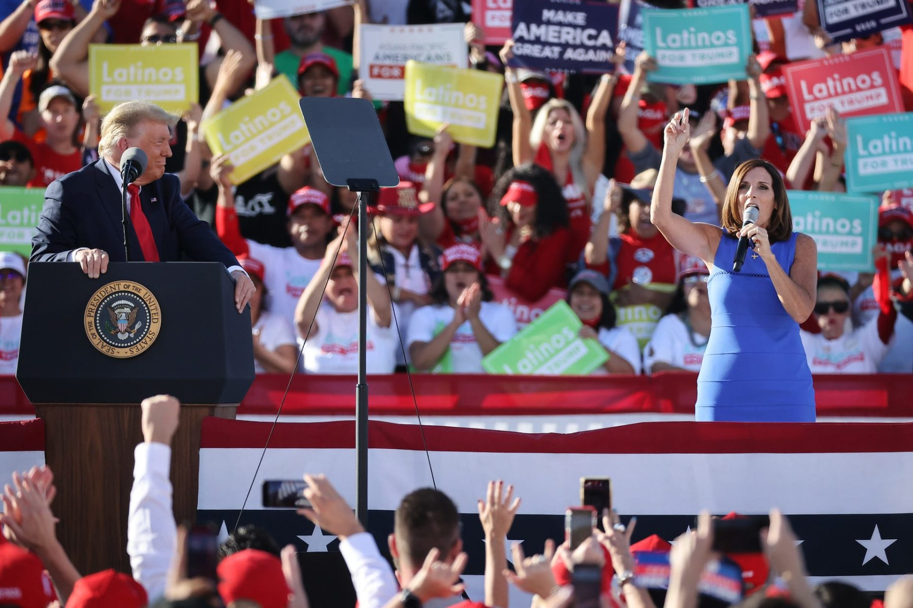 GOODYEAR, ARIZONA - OCTOBER 28: Sen. Martha McSally (R-AZ) (R) praises U.S. President Donald Trump during a campaign rally at Phoenix Goodyear Airport October 28, 2020 in Goodyear, Arizona. With less than a week until Election Day, Trump and his opponent, Democratic presidential nominee Joe Biden, are campaigning across the country. (Photo by Chip Somodevilla/Getty Images)