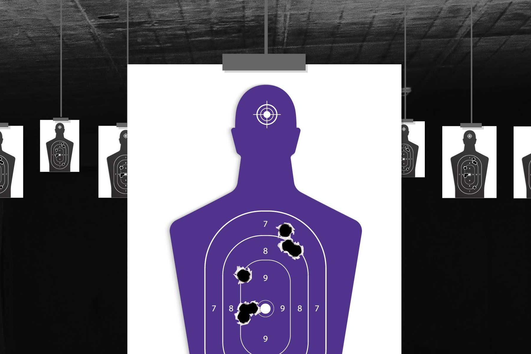 A paper target for shooting with holes in it.