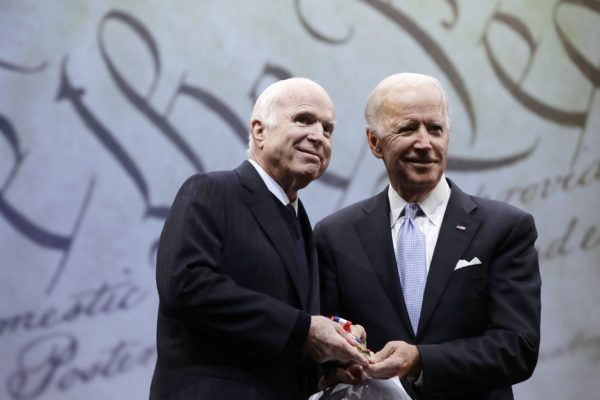 Sen. John McCain and Joe Biden together on stage.