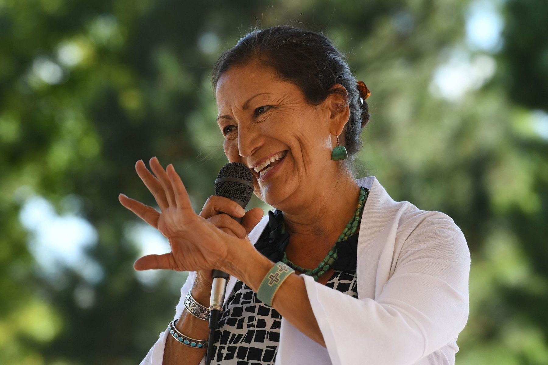 Deb Haaland, one of the first Native Americans in Congress, waves.