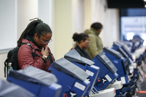 Voters cast their ballots at the polling place in downtown Chicago, Illinois on April 2, 2019. - Chicago residents went to the polls in a runoff election Tuesday to elect the US city's first black female mayor in a historic vote centered on issues of economic equality, race and gun violence. Lightfoot and Toni Preckwinkle, both African-American women, are competing for the top elected post in the city. (Photo by Kamil Krzaczynski / AFP) (Photo credit should read KAMIL KRZACZYNSKI/AFP via Getty Images)
