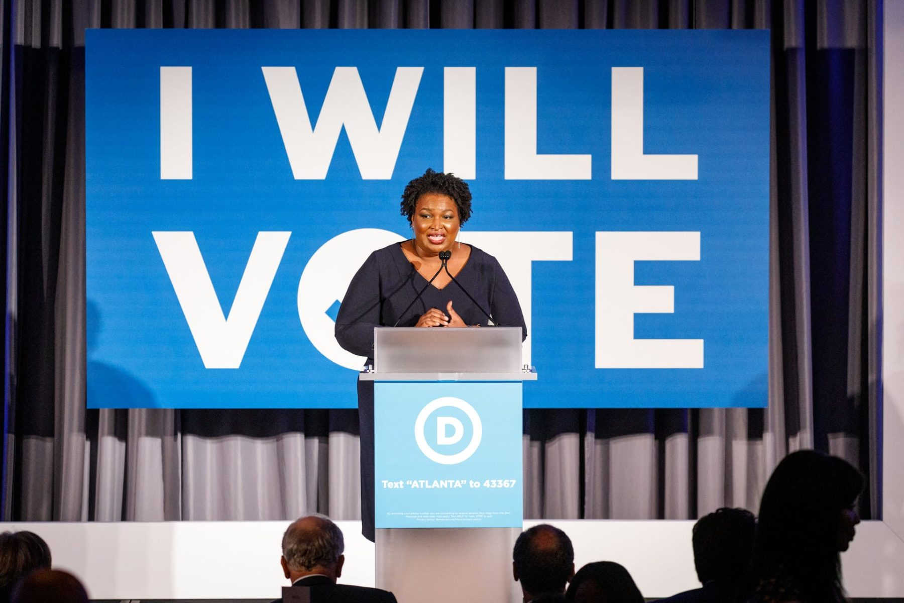 Stacey Abrams speaks at a podium.