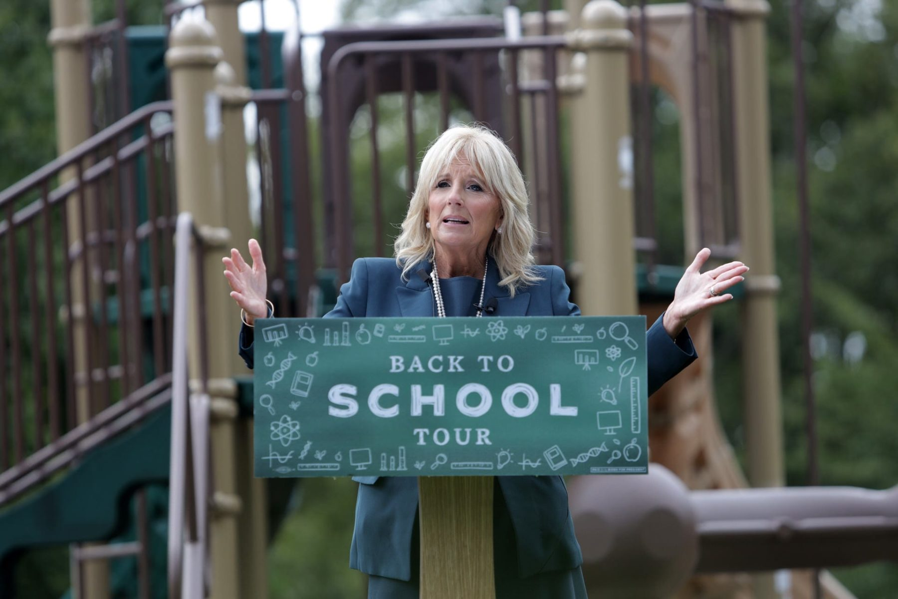 Jill Biden speaking at a podium at a playground.