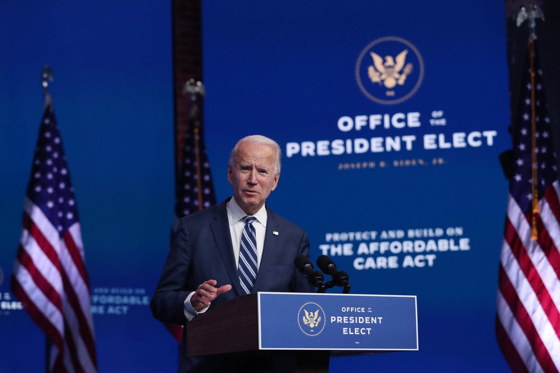 Joe Biden stands at a podium.