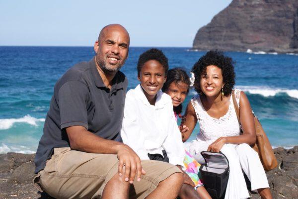 A family sits on a beach
