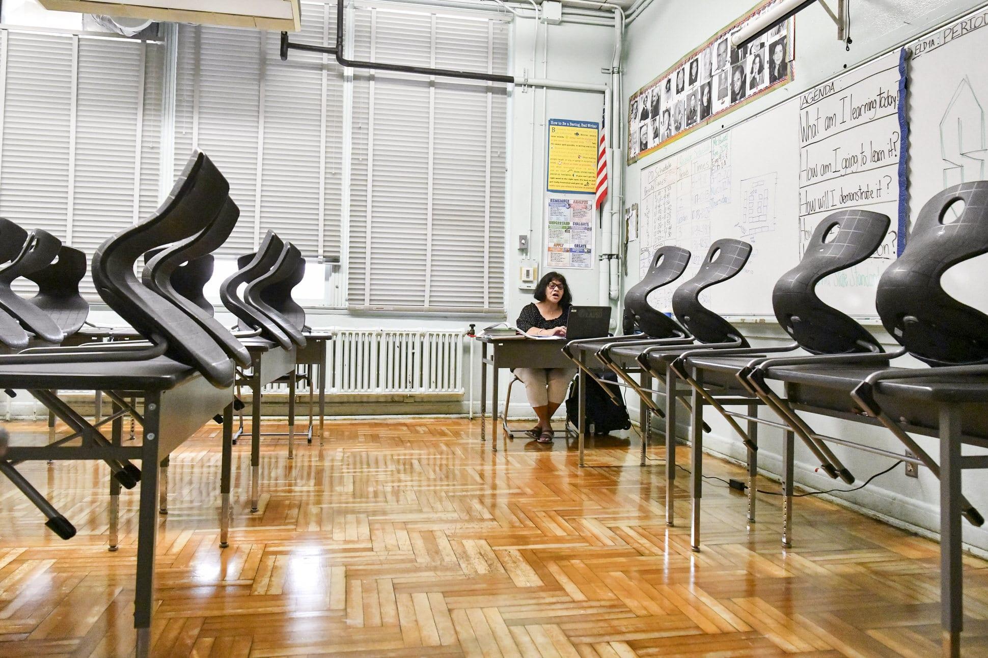 Teacher conducts class from an empty classroom.