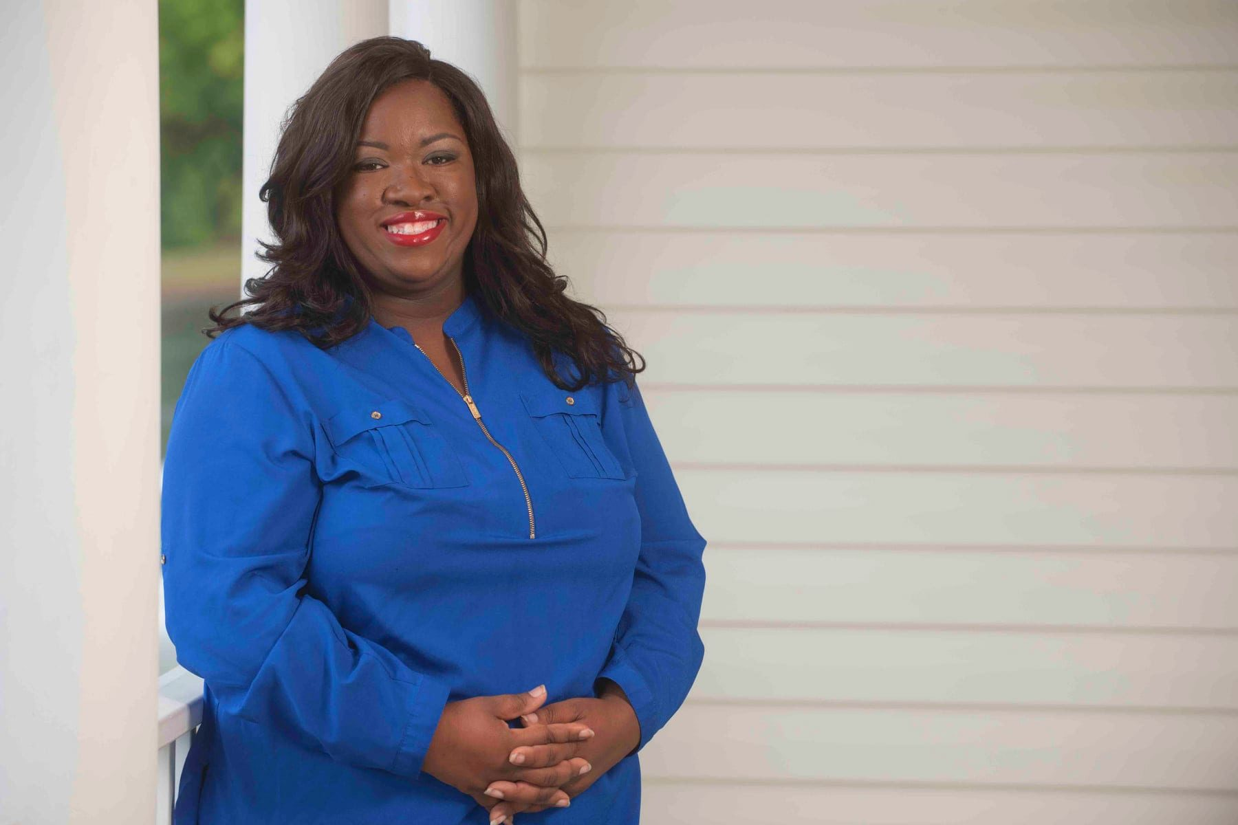 Candi King, photographed here in a blue outfit, won a special election the Virginia House of Delegates, bringing the total number of women in the state's General Assembly to 42, a record.