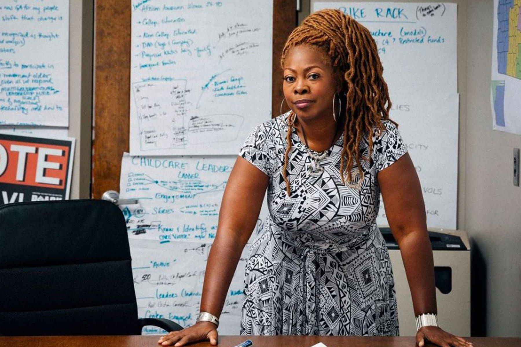 Latosha Brown standing behind a desk.
