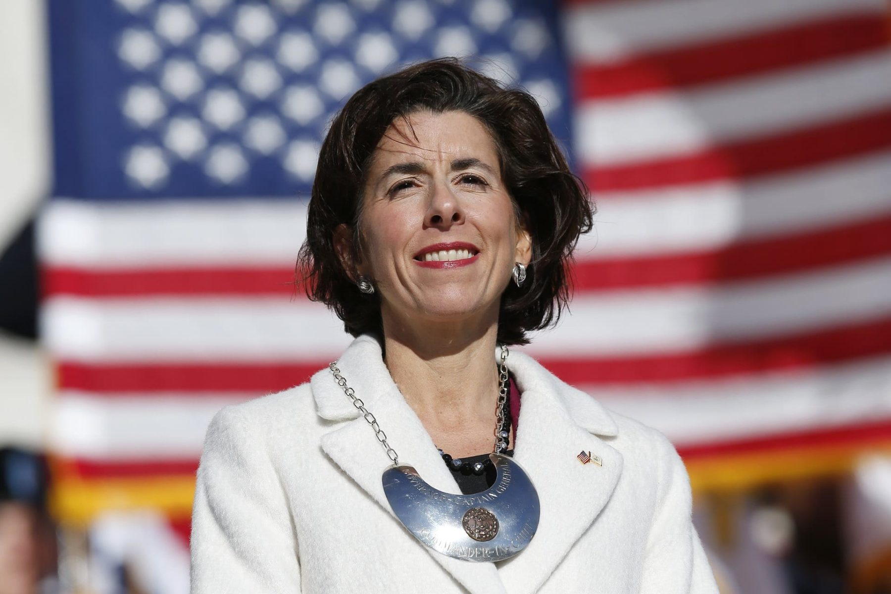 Gina Raimondo stands on the State House.