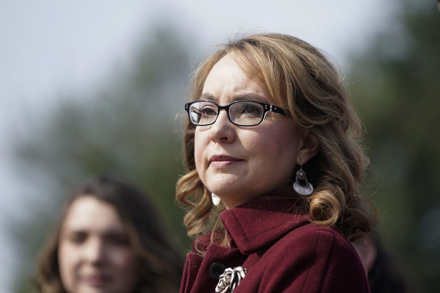 Former Rep. Gabby Giffords listens to lawmakers.