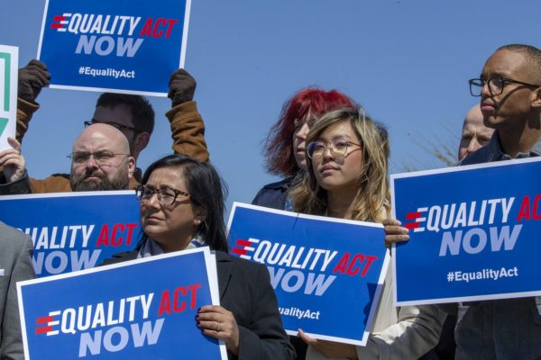 Protesters stand in support of a introduction of the Equality Act.