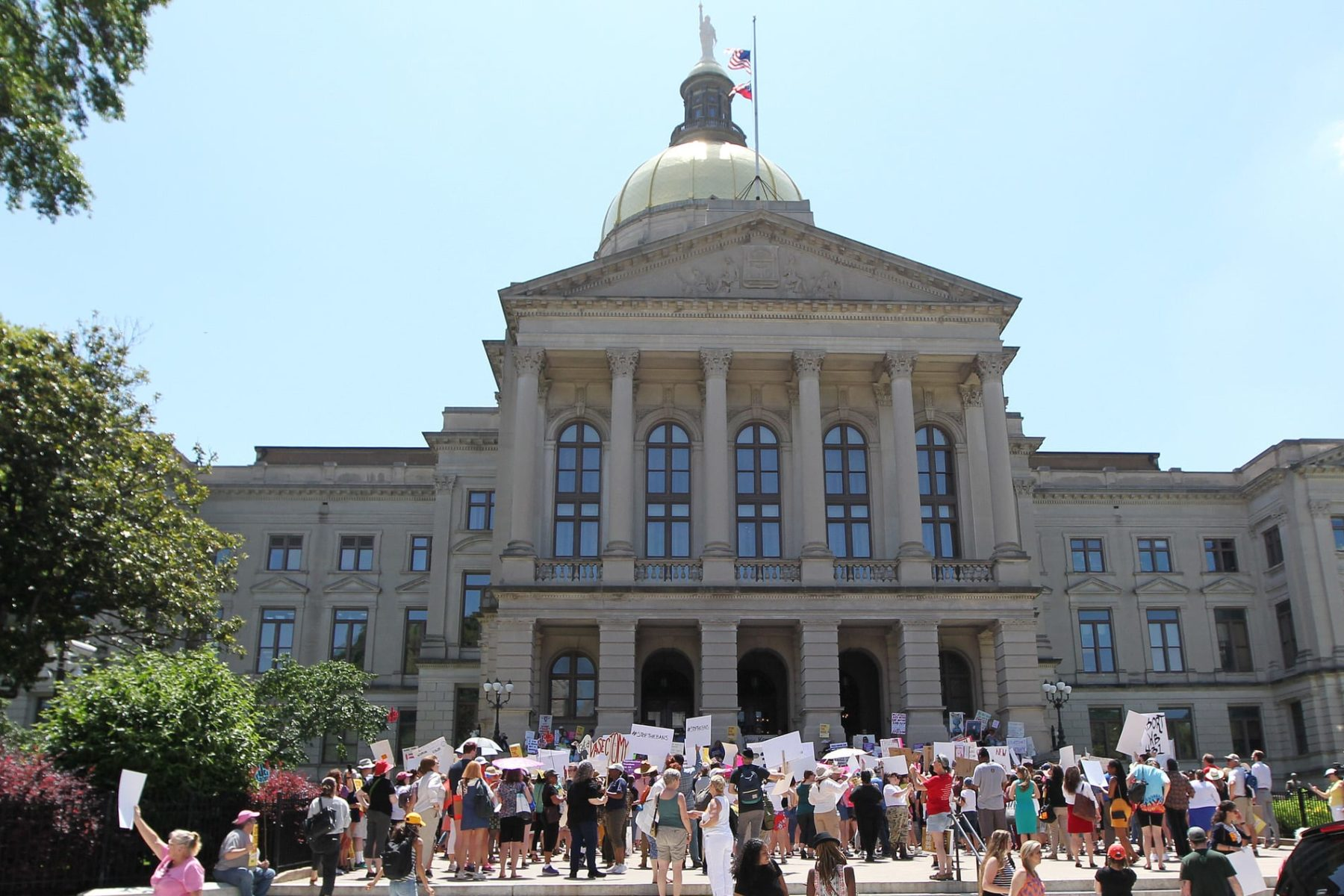 Abortion rights advocates rally in front of the Georgia State Capitol.