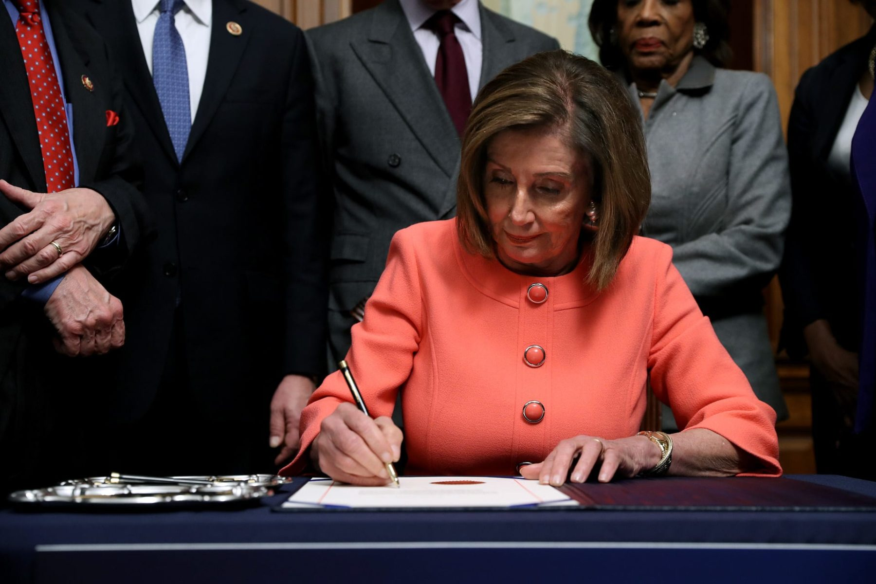 U.S. Speaker of the House Nancy Pelosi (D-CA) signs the articles of impeachment.