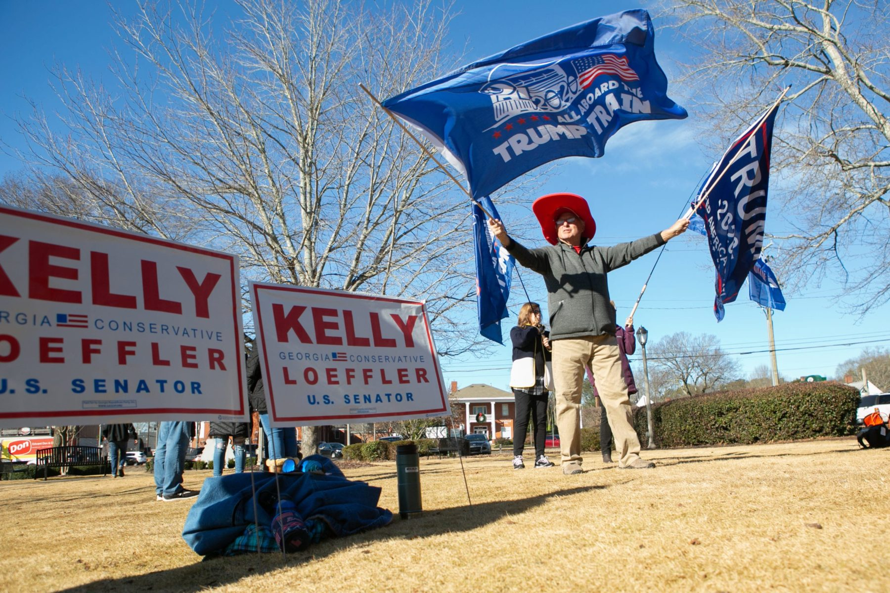 WOODSTOCK, GA - DECEMBER 29: Gary White waves Trump flags during a Senate Firewall campaign rally for Sen. Kelly Loeffler (R-GA) at The Park at City Center on December 29, 2020 in Woodstock, Georgia. Loeffler faces Democratic Senate candidate Raphael Warnock in the runoff election that will determine control of the U.S. Senate. With a week until the January 5th runoff election, candidates continue to campaign throughout Georgia. (Photo by Jessica McGowan/Getty Images)