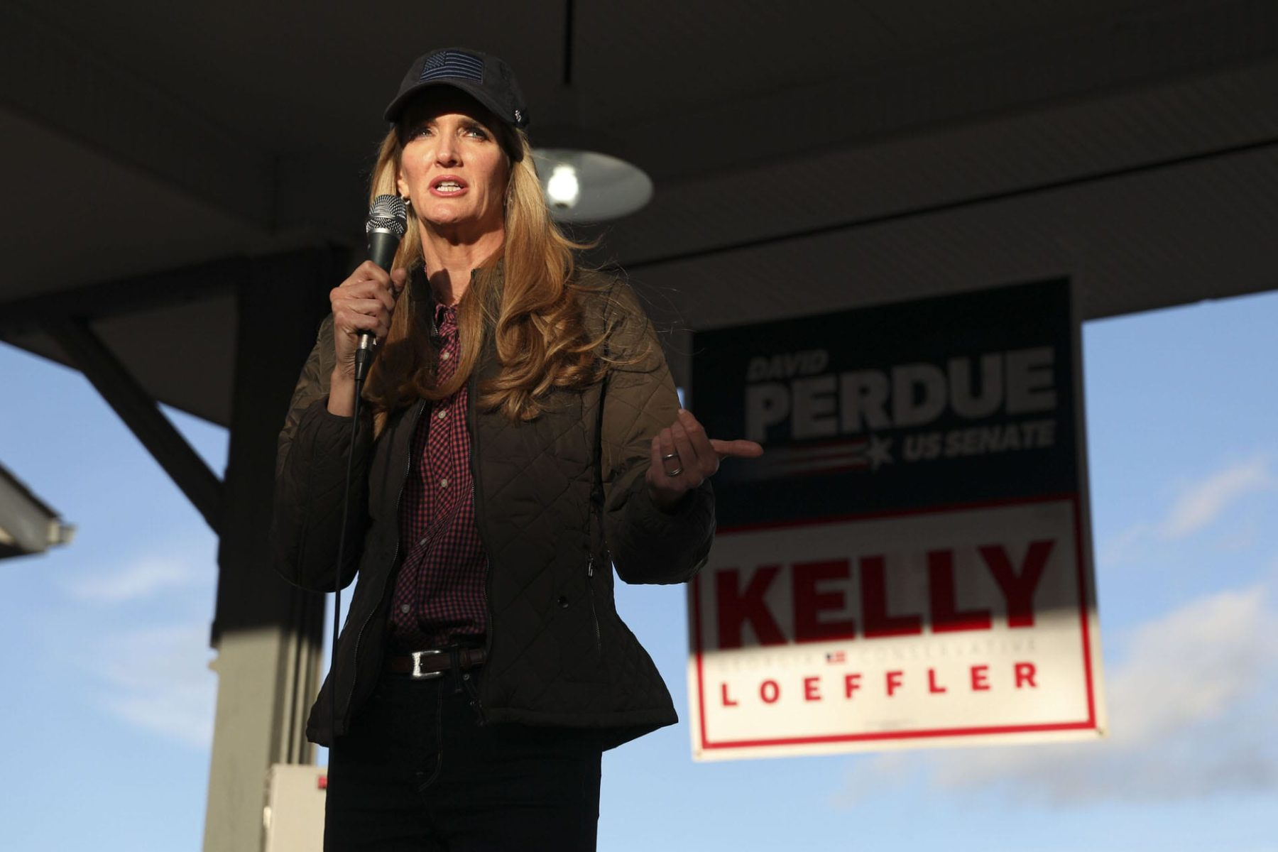 Senator Kelly Loeffler speaks to supporters during a rally.