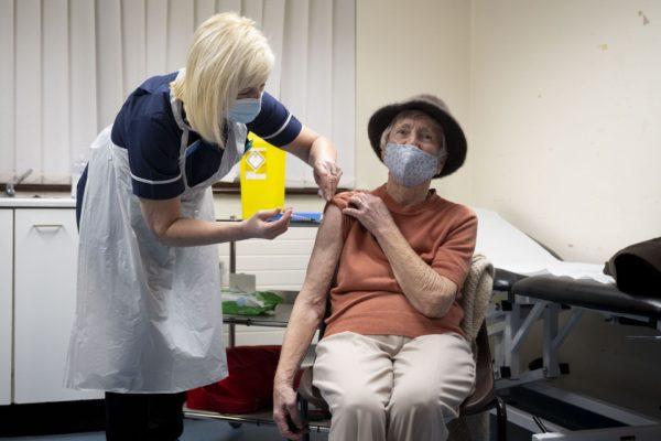 A woman receives the Oxford-AstraZeneca Covid-19 vaccine.