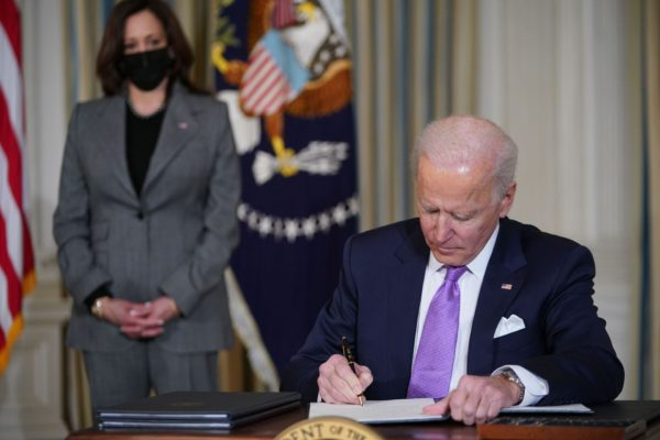 Joe Biden signs executive orders.