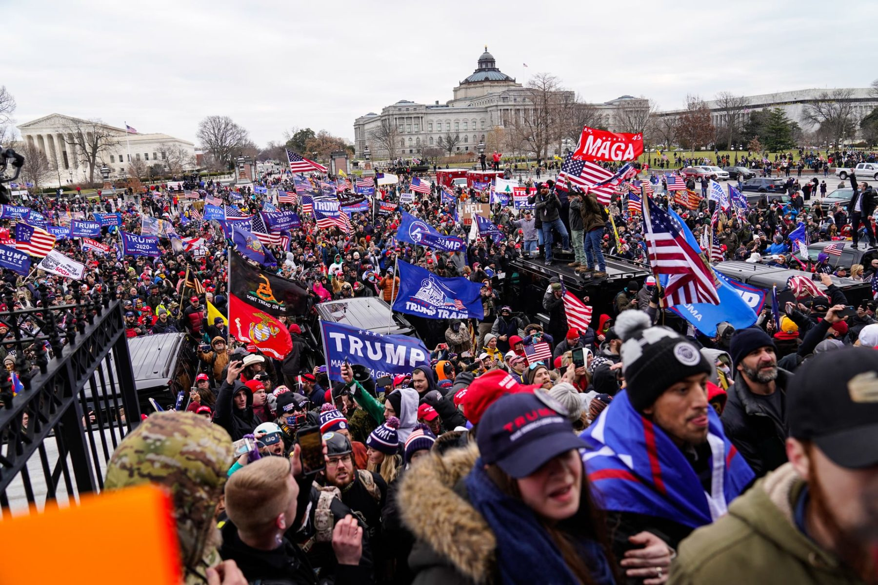 A crowd of pro-Trump supporters riot in front of the Capitol.