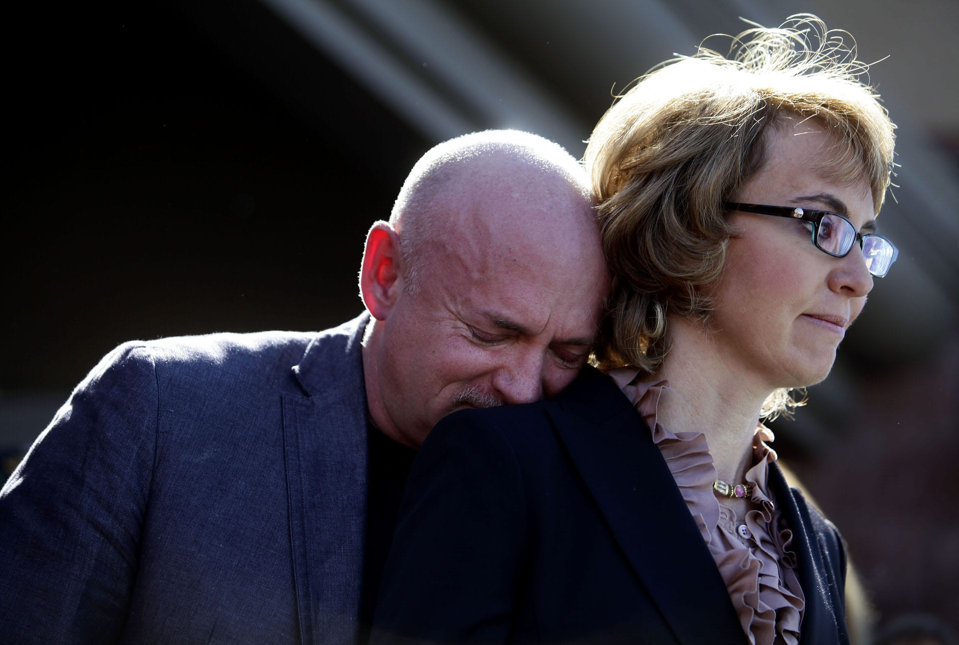 Mark Kelly leans his head on the shoulder of his wife and former Congresswoman Gabby Giffords.