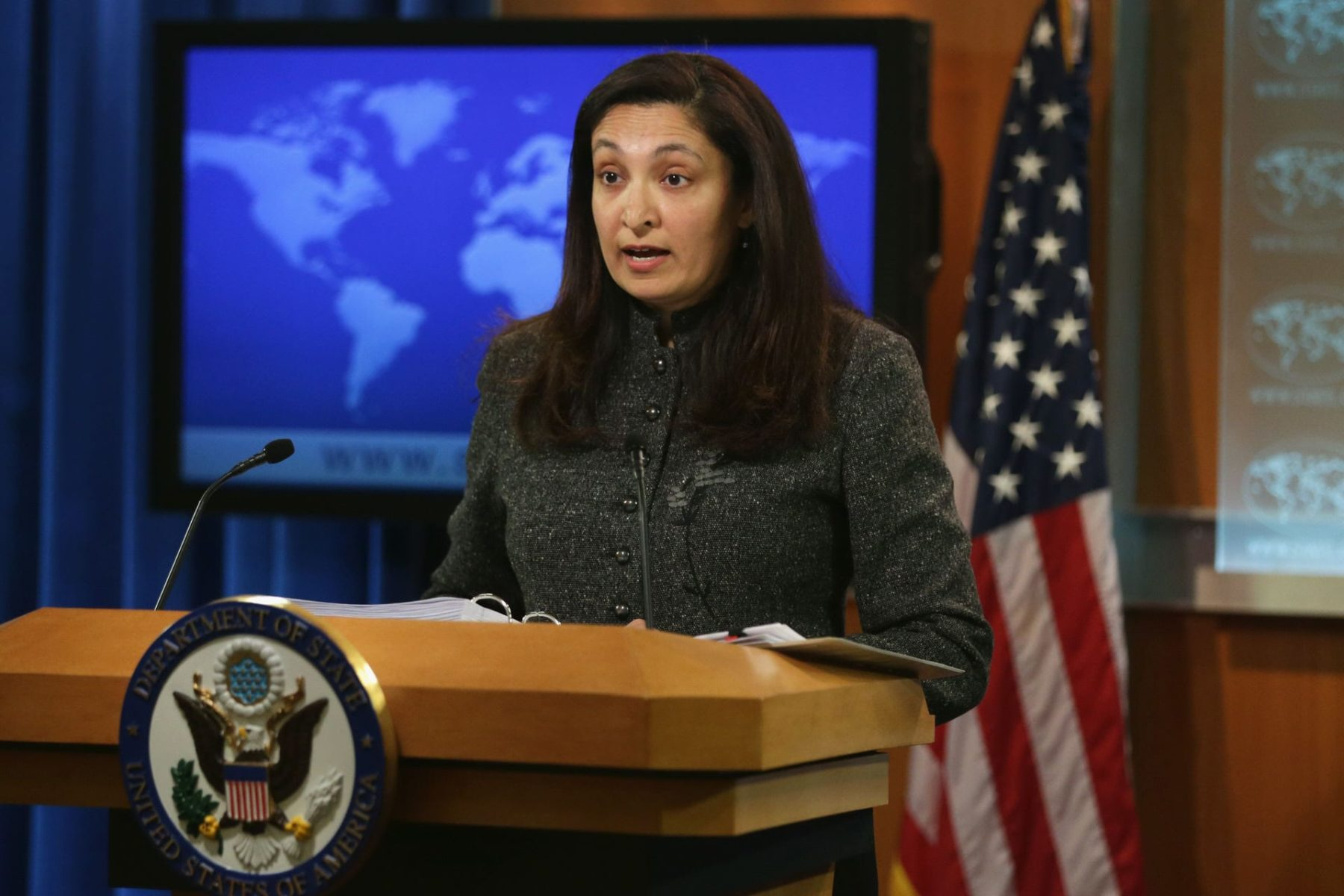 Acting Assistant U.S. Secretary of State for Bureau of Democracy, Human Rights and Labor Uzra Zeya speaks at a podium.
