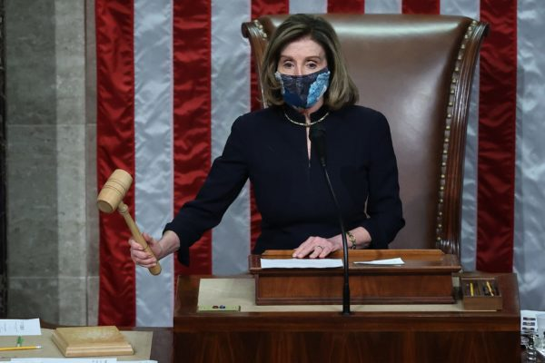 Nancy Pelosi gavels after Trump is impeached for the second time.
