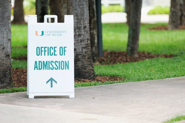 A sidewalk sign for the University of Miami Office of Admissions.