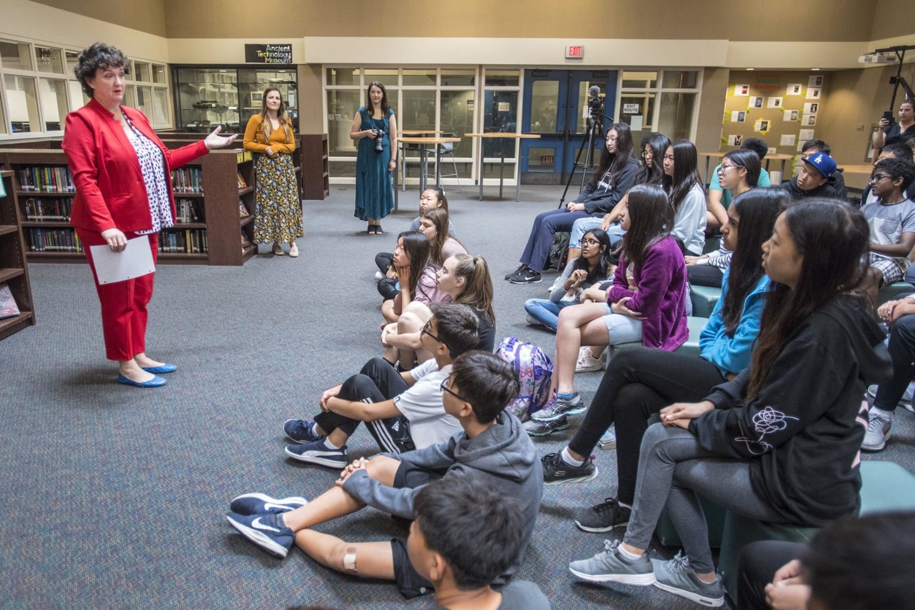 A photo of Katie Porter speaking to middle school students.