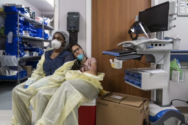 Two members of a medical staff rest in the ICU.
